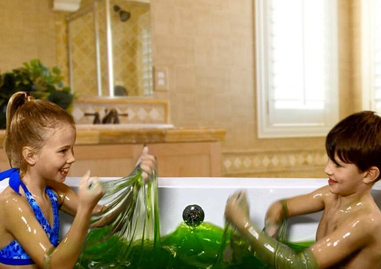 Boy and Girl Playing With Green Slime Baff in Bath 2015 hottest kids toys