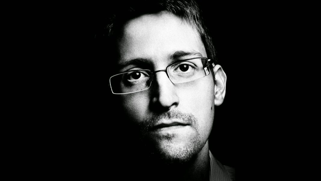 edward snowden hero or handcuffs 2015 images