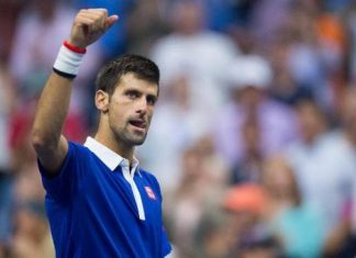novak djokovic moves forward at paris masters 2015 tennis images
