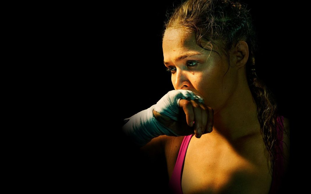 ESPN is pushing their piece on Ronda Rousey in the December issue of ESPN The Magazine. Big time. Ramona Shelburne got the first interview with the former UFC Bantamweight Champion after the devastating knockout at the hands of Holly Holm in November. The piece is featured on the front page of ESPN even as the NFL playoffs are just weeks away. Rousey, even in defeat, is an enormous draw to even the casual sports fan. The interview gives us some insight on how Rousey is dealing with the fact that she will not retire from the UFC undefeated. Holm made sure of that with a nasty head kick that rendered the