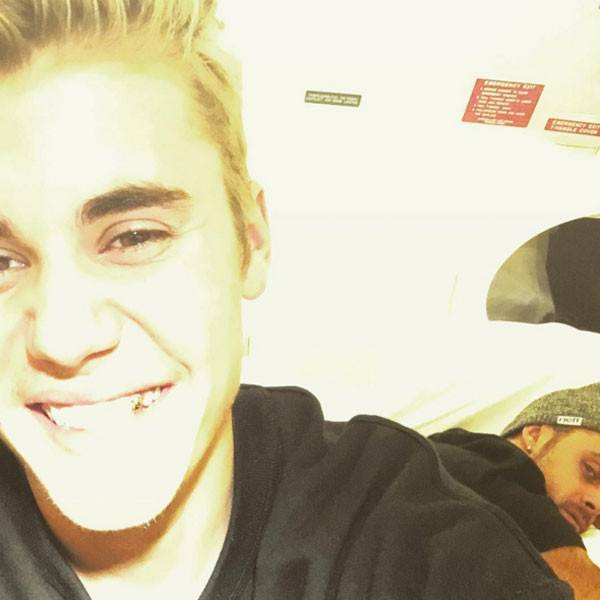 justin bieber spreads joy to world with gold tooth 2015 gossip