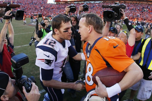 tom brady going down on peyton manning for broncos patriots 2016 images