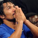 Manny Pacquiao holds tight to his Bible after Nike dump