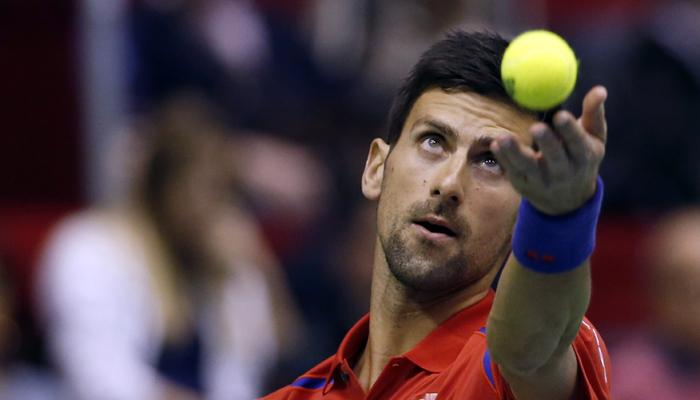 novak djokovic continues winning ways at davis cup