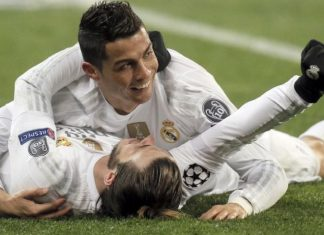 cristiano ronaldo with gareth bale laying down soccer 2016 images