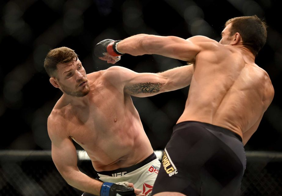 MMA Weekly: Michael Bisping topples Luke Rockhold and Cruz dominated Faber 2016 images