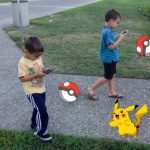 kids playing walking pokemon go