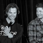 jared paleckis smiling at jensen ackles bulge on stage