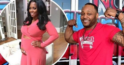 keisha knigh pulliam showing off belly