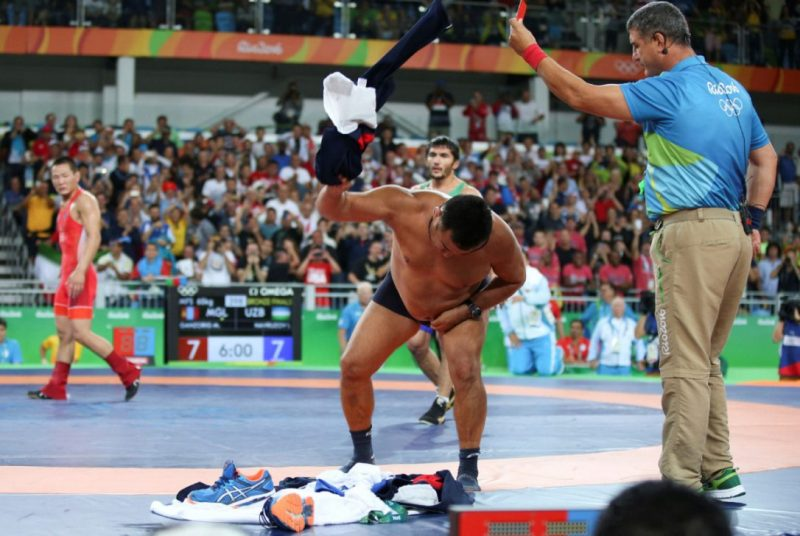 mongolian coaches strip to protest rio olympics