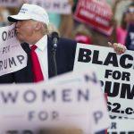 donald trump kissing women for trump sign