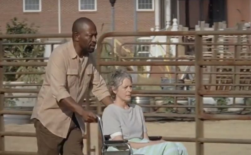 the walking dead morgan pushing carol in wheelchair 702