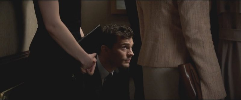 fifty shades darker jamie dornan on knees elevator