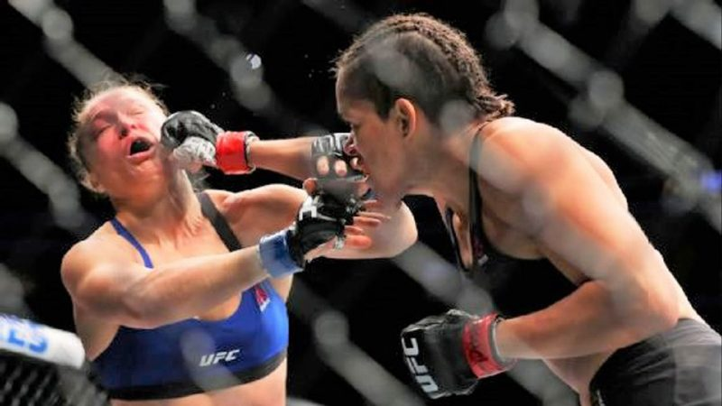 ronda rousey takes hit from amanda nunes