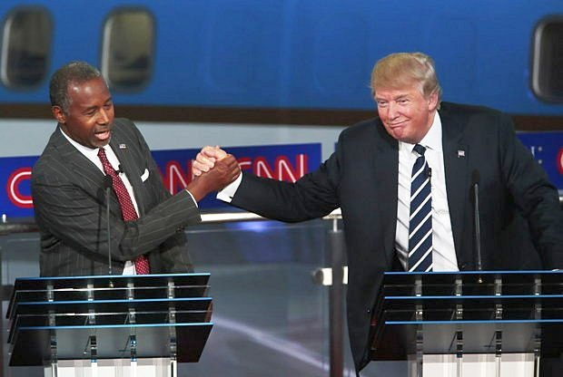 ben carson hand tight with donald trump