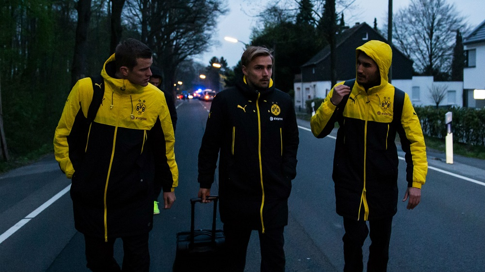 borussia dortmund team work to overcome bomb attack 2017 images