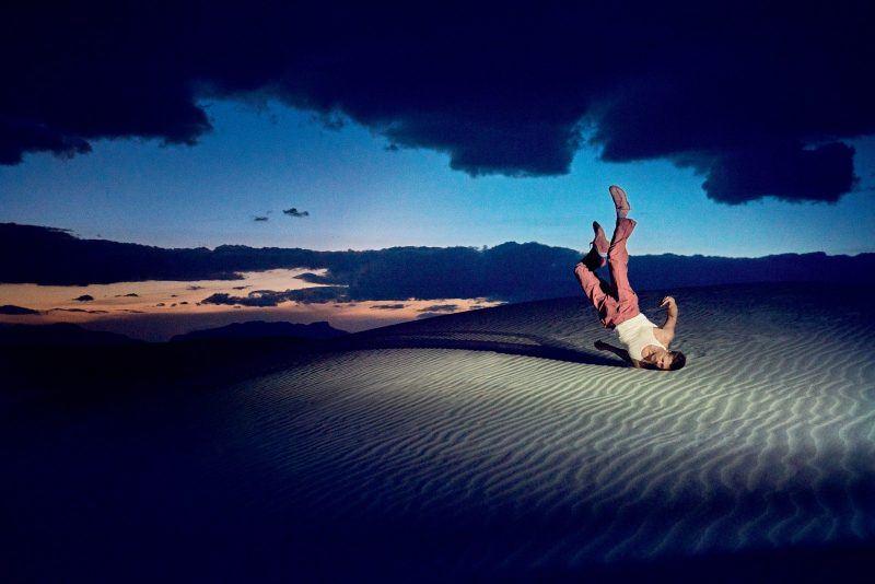brad pitt sand desert arm lift