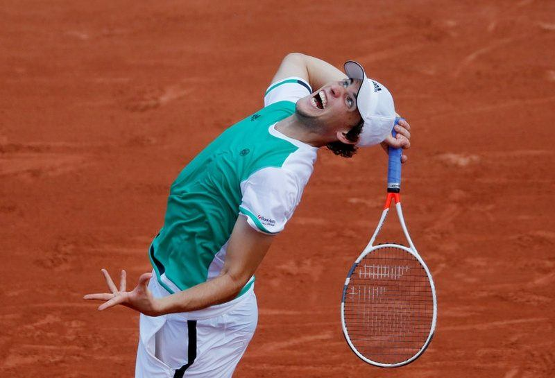 dominic thiem attacks ball at french open 2017