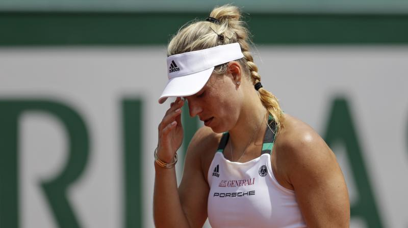angelique kerber knocked out of french open 2017 images