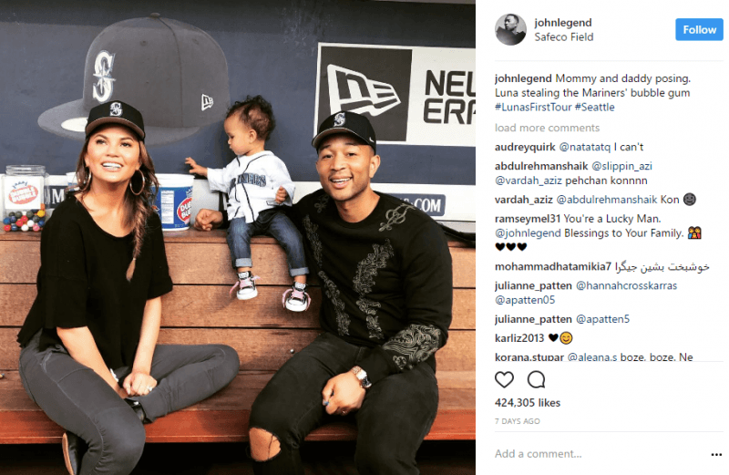 chrissy teigen john legend with baby at red sox game