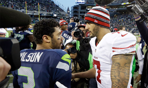 colin kaepernick gets a pass from seahawks, pete carroll 2017 images