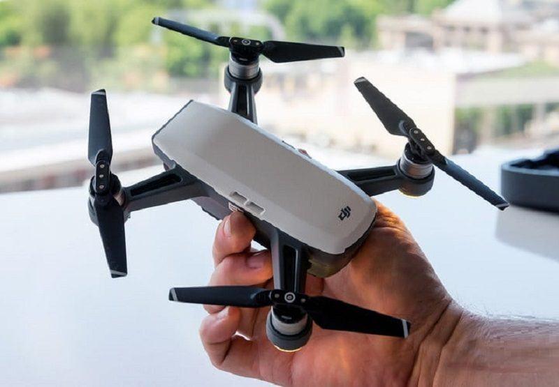 dji spark drone mini in hand