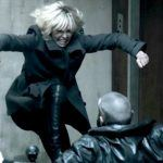charlize theron kicking man down in atomic blonde movie