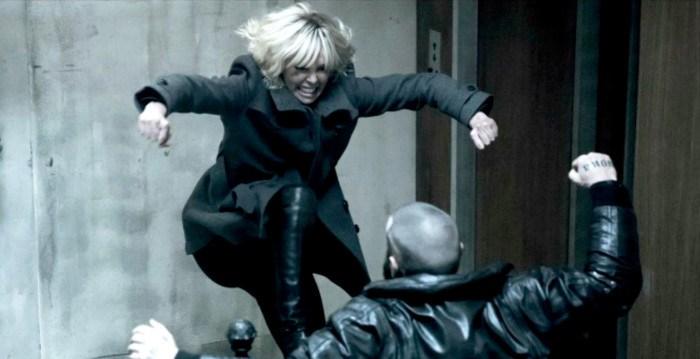 charlize theron kicking man down in atomic blonde movie
