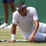 macos baghdatis slips on wimbledon courts