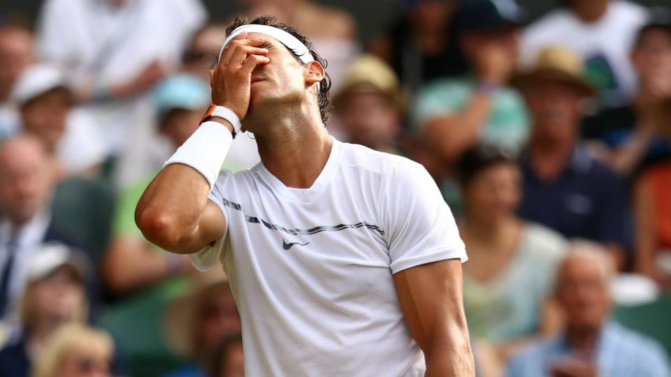 rafael nadal fights hard but loses to gilles muller wimbledon 2017 images