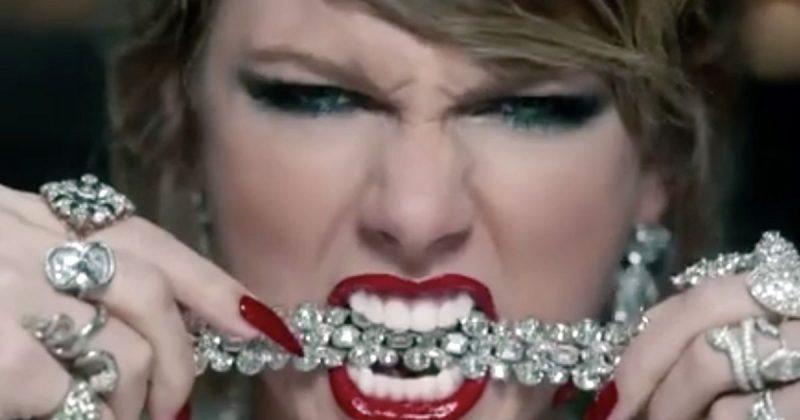 taylor swift mtv video biting necklace
