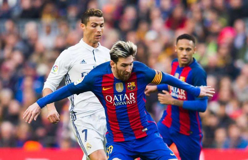 lionel messi pushing cristiano ronald out of way soccer
