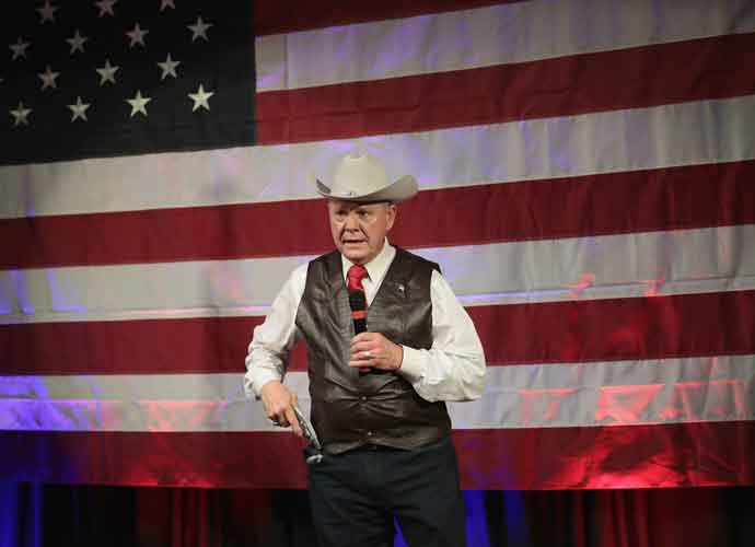 roy moore cowboy hat and pistol