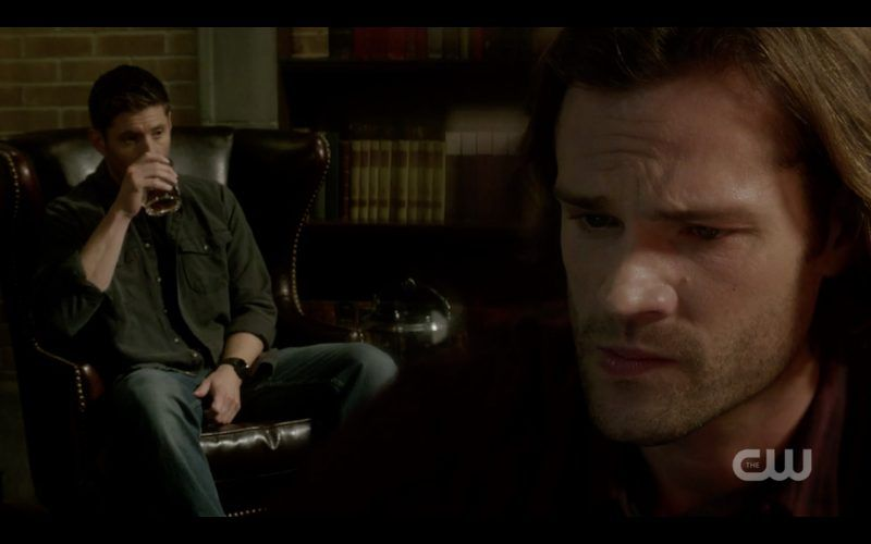supernatural dean winchester drinking while sam looks concerned 1307