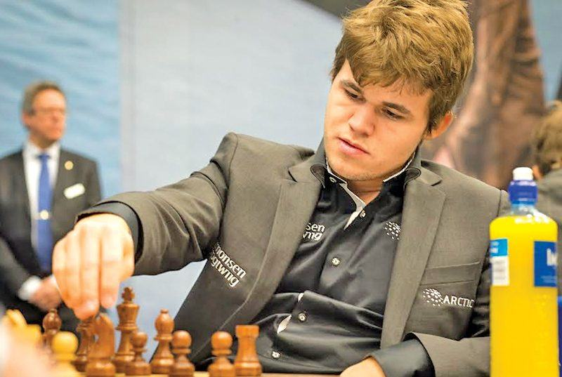 magnus carlsen defends his title in 2018
