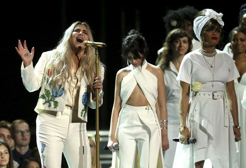 kesha performs praying at grammys 2018 with camila cabello and andra day images