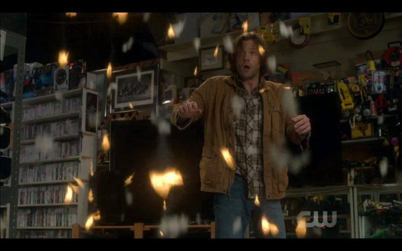 supernatural sam winchester fighting off fire in sky shop