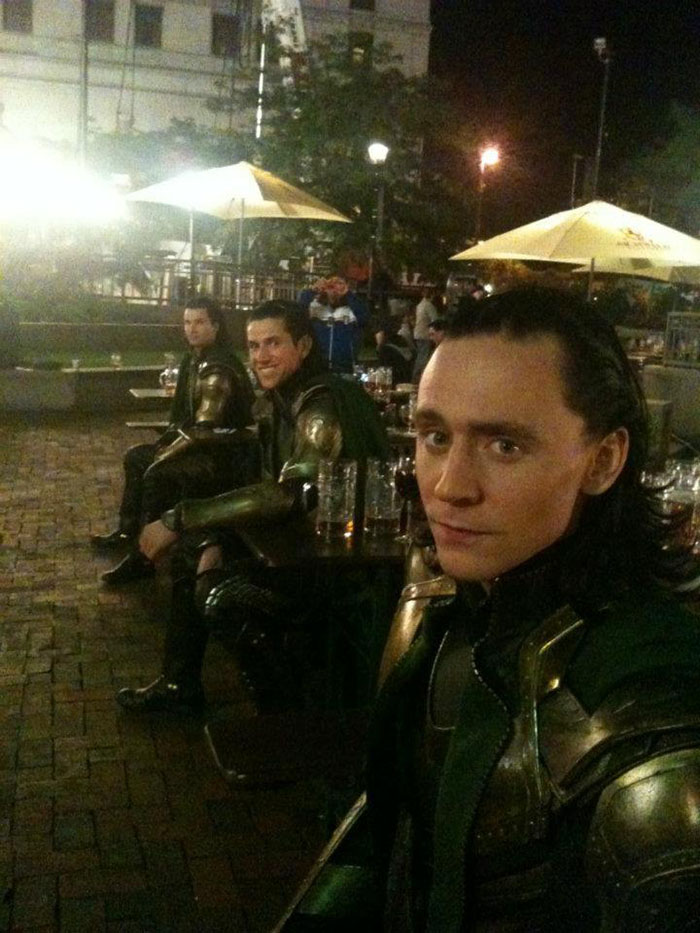 It takes a few men to tackle Tom Hiddleston's Loki