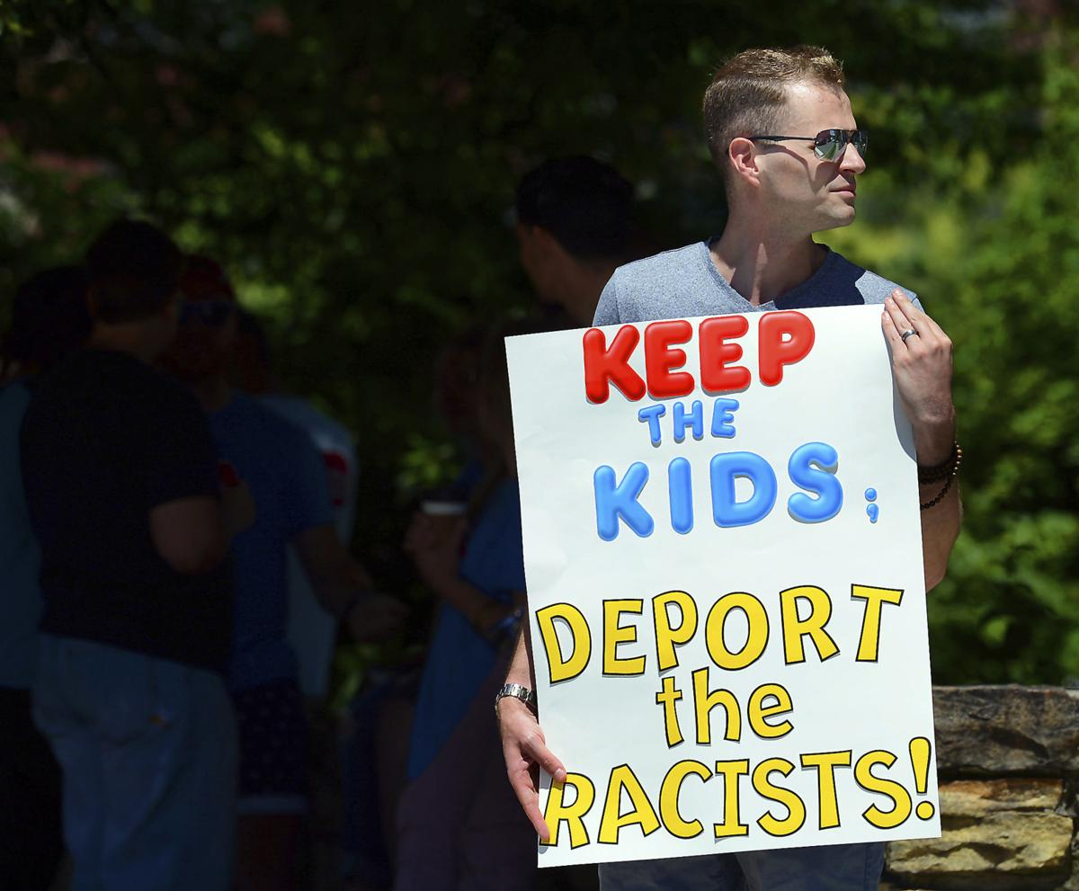 donald trump protestor keep the kids deport the racists banner