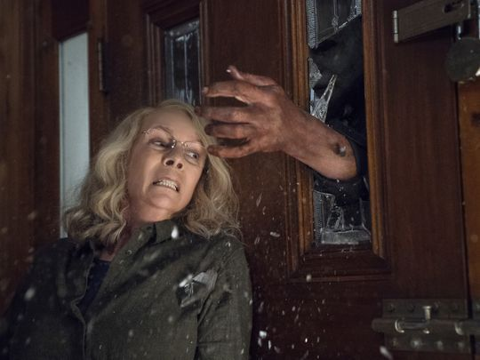 jamie lee curties avoiding michael myers hands through window halloween movie 2018]