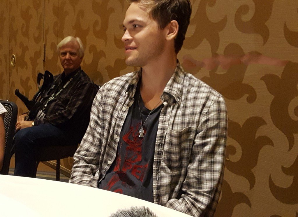 alex calvert smiling for mttg at comic con interview