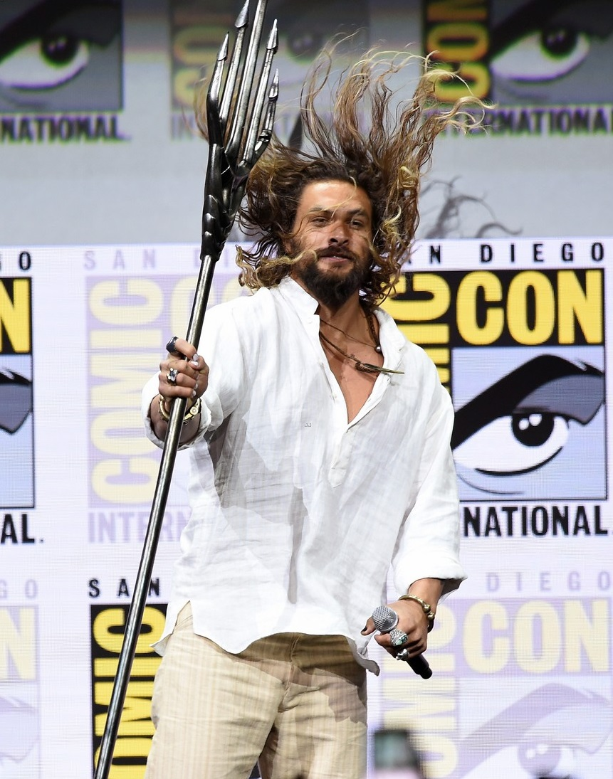 jason momoa works his trident at comic con 2018