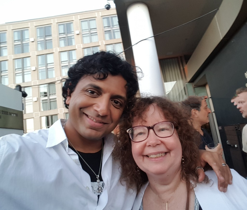 m night shyamalan with movie tv tech geeks lynn zubernis