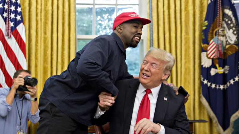 kanye west giving donald trump awkward hug at white house