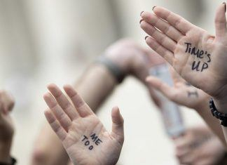 metoo times up protestors hand marks over Brett Kavanaugh