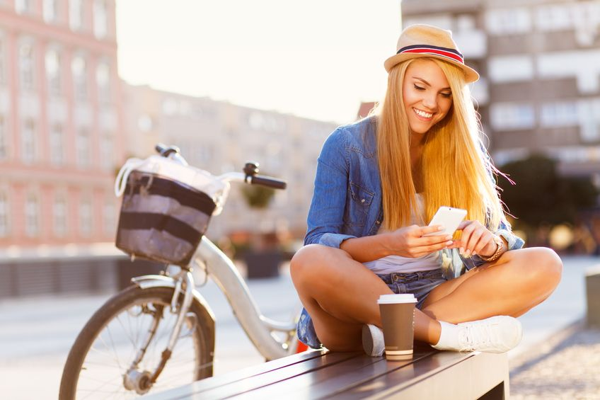 young woman using chat app in new city benefits of talking to strangers online
