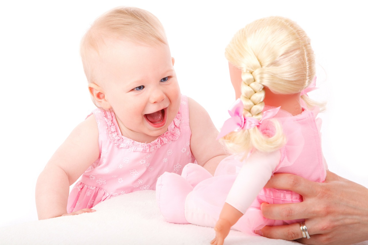 baby girl happy smile with baby doll holiday gifts