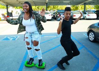 black woman trying hoverboard first time with black gay man games