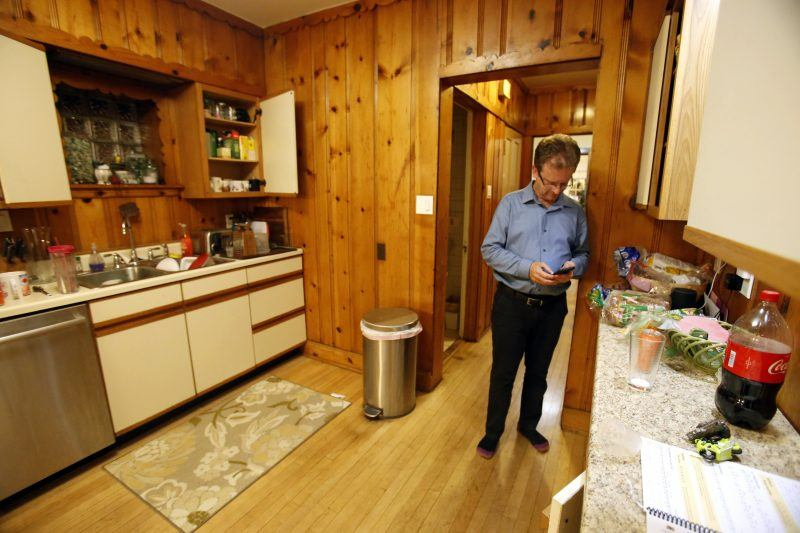 father sneaking into kitchen to check social media