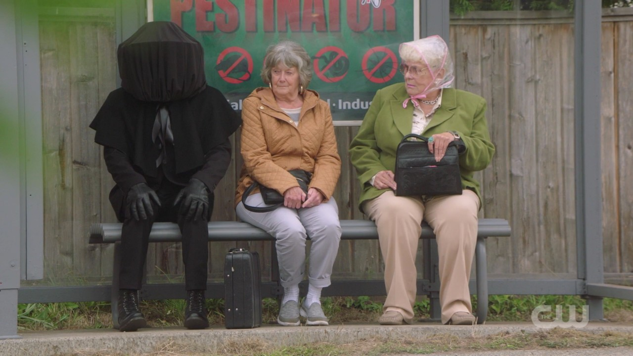 supernatural musca fly man sitting at bus stop with old women 1406